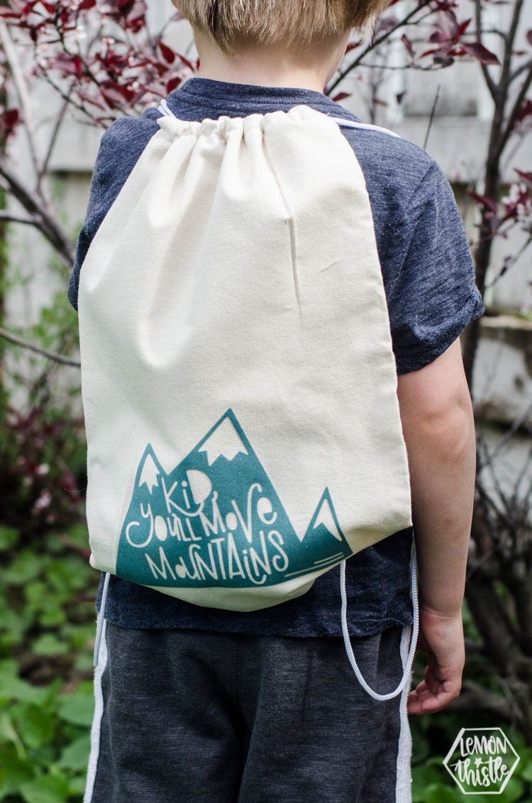 Kid, You'll move mountains drawstring bag on kids back