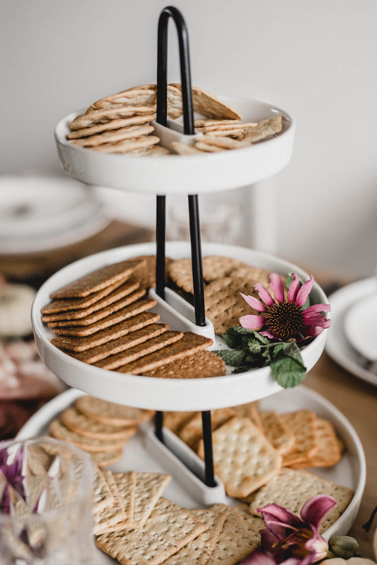 Hairpin tiered serving tray with crackers and coneflower
