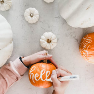 hand lettering with paint marker on pumpkins