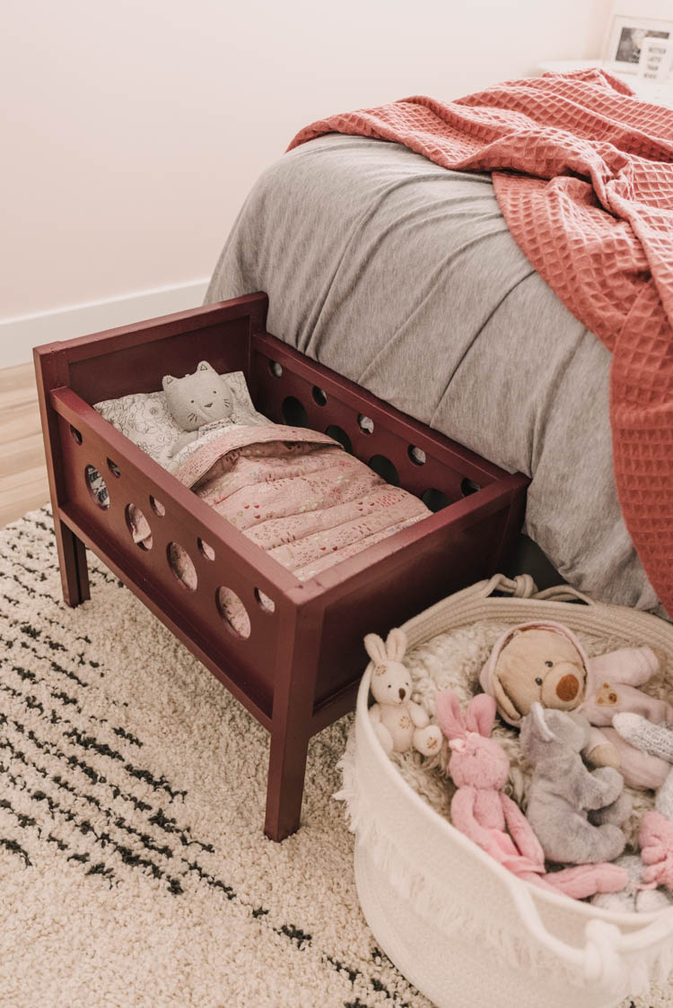 Refinished wood doll crib- love the modern sheet set!