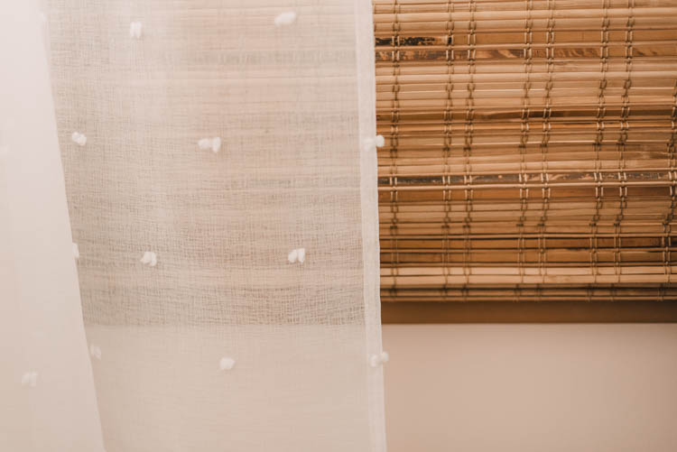 Sheer curtains over bamboo shade- great texture!
