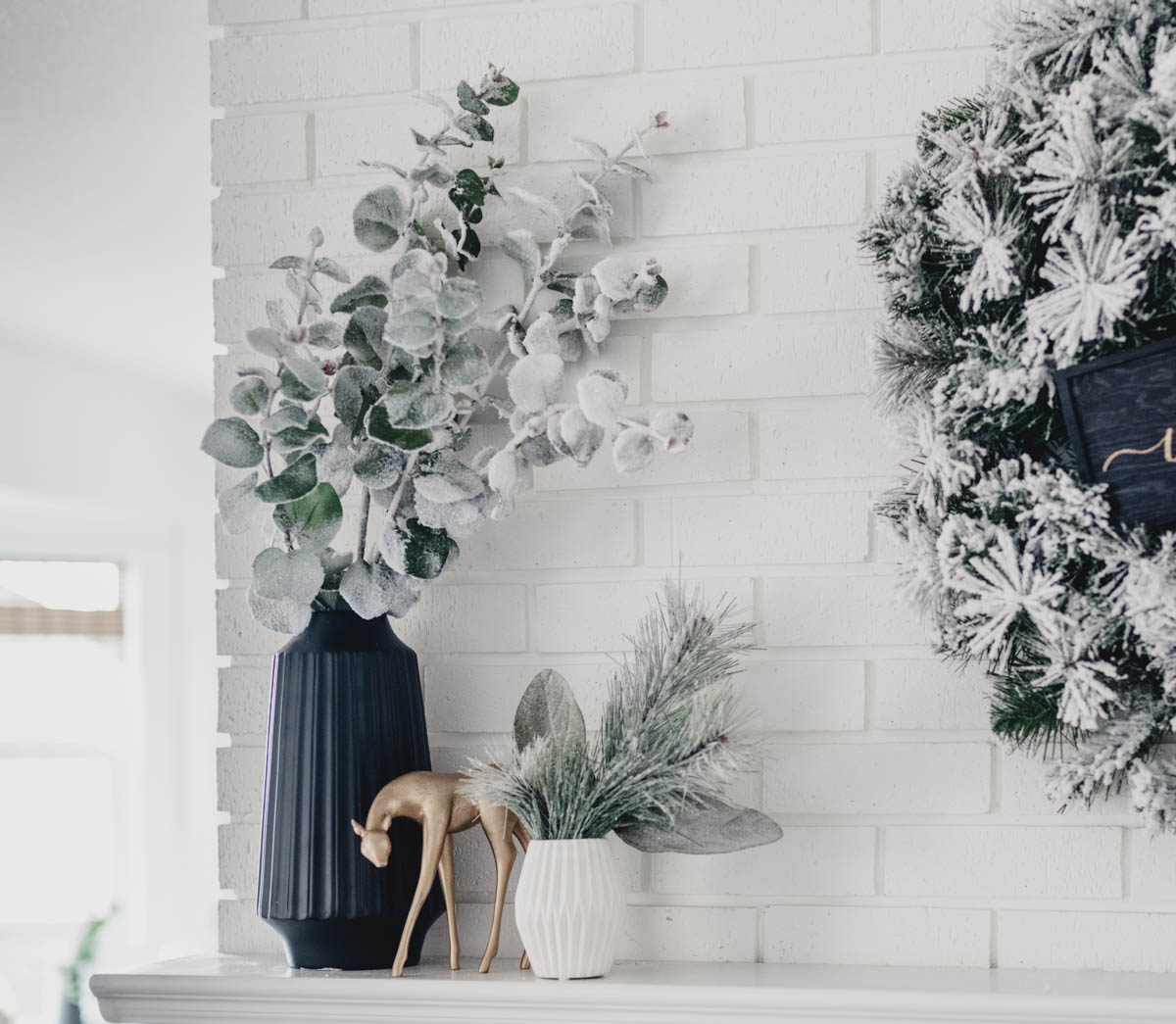 Modern holiday mantel with flocked greenery, black and white! And a letterboard ;)