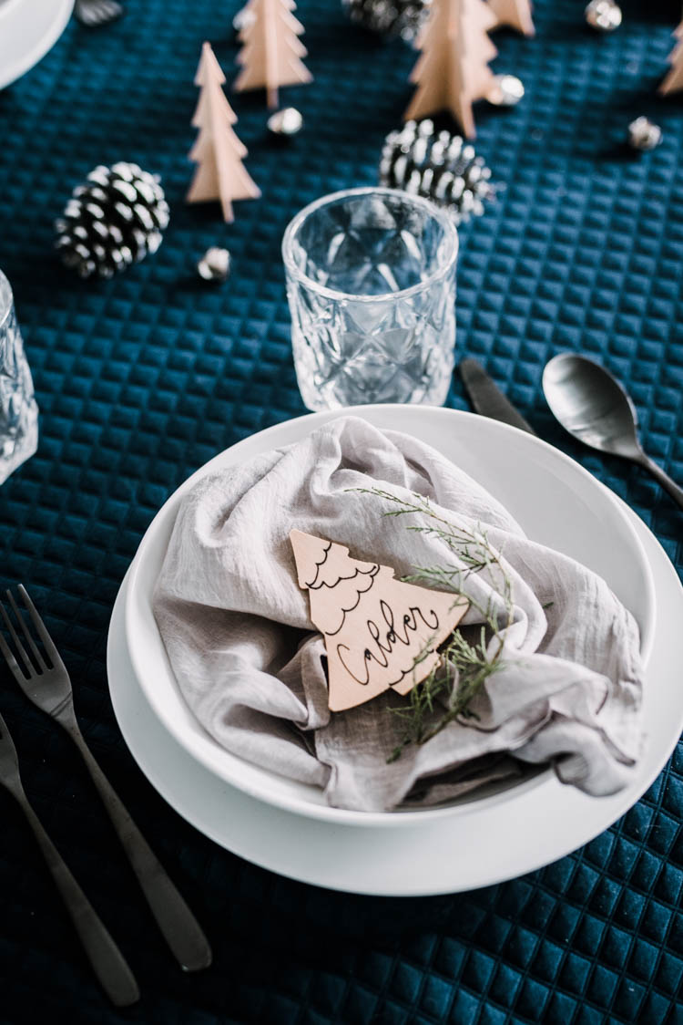 Cute little wooden place cards for a modern christmas table setting