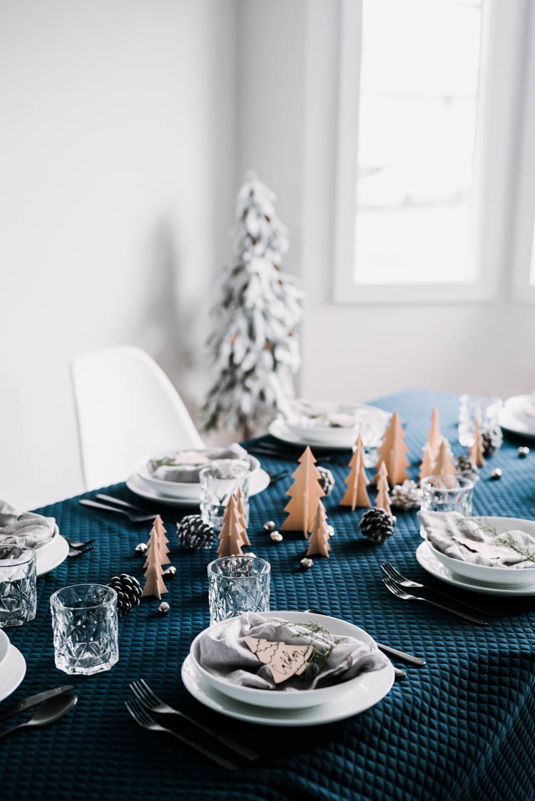 Beautiful modern winter tablescape with wooden trees