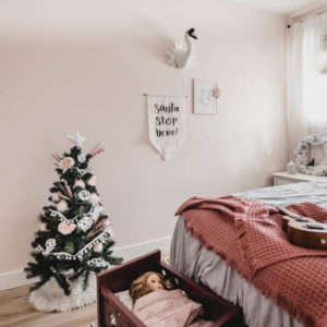 Cute little christmas tree in a girls bedroom