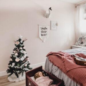 Cute little christmas tree in a girls bedroom