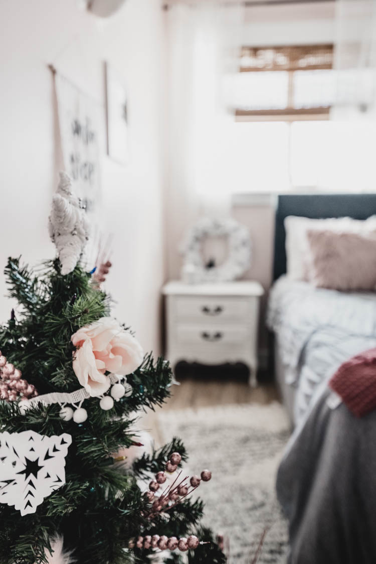 so pretty for a little girl! pink and white holiday decor. Girls bedroom christmas room tour with flowers on the tree