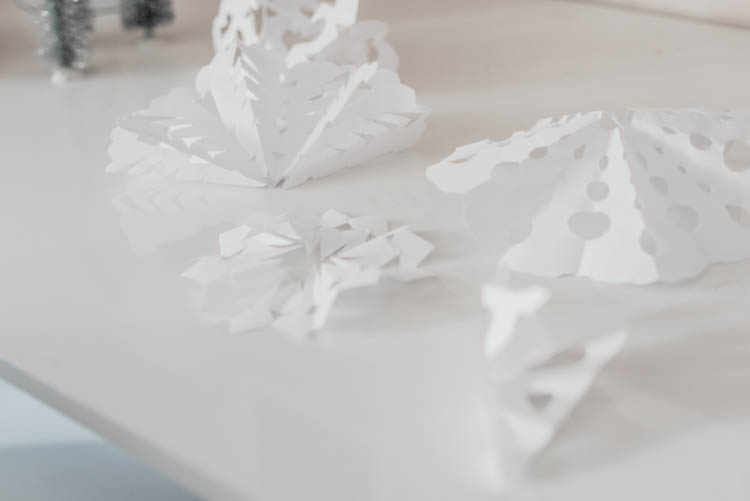 Cutting out paper snowflakes for Christmas