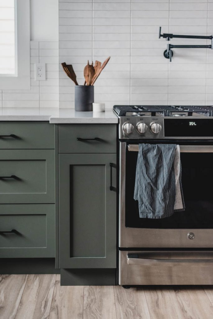 Love this range and green cabinet combo