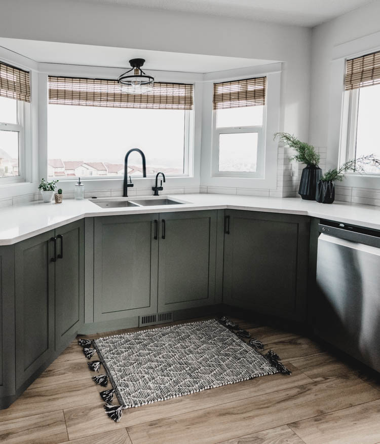 Kitchen cabinets in a bay window- love this layout