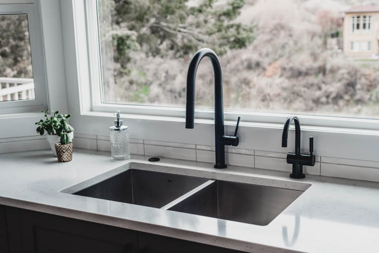 I thought a hot water dispenser and faucet and garbage disposal switch would look crowded, but it's all so sleek and beautiful