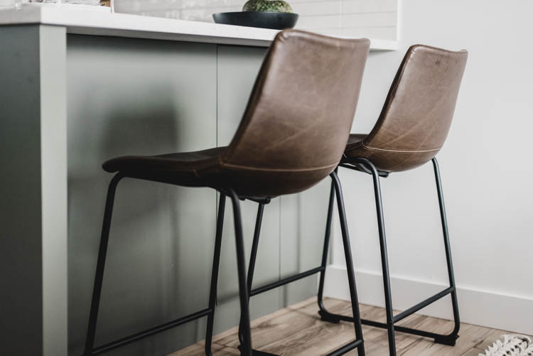 Modern leather stools for a green kitchen