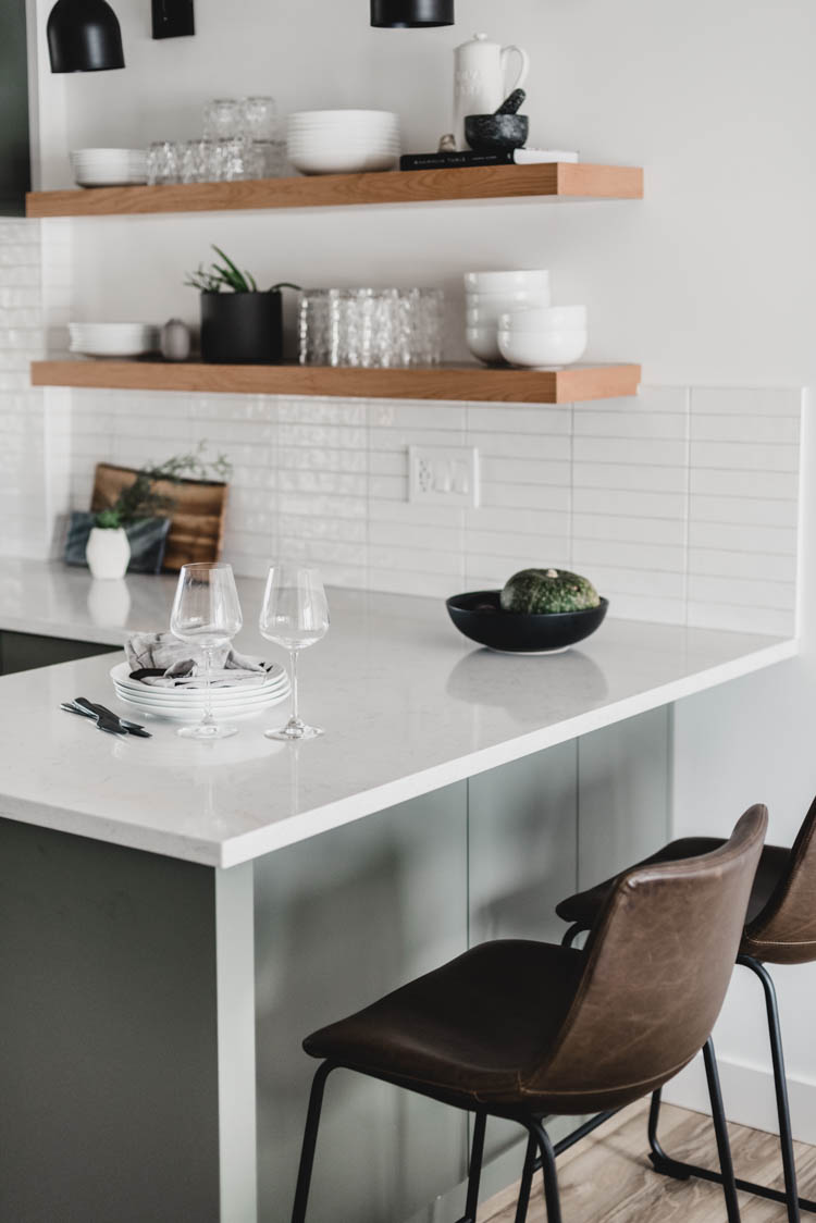 small peninsula with open shelving in kitchen