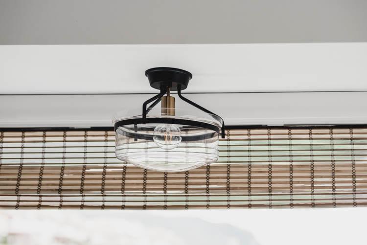 Semi flush mount light over sink in bay window