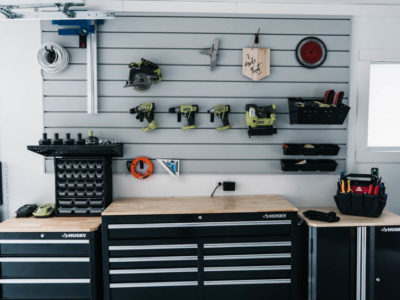 I love this for a small garage turned workshop while still having great storage! Garage Workshop Transformation - before and after + details