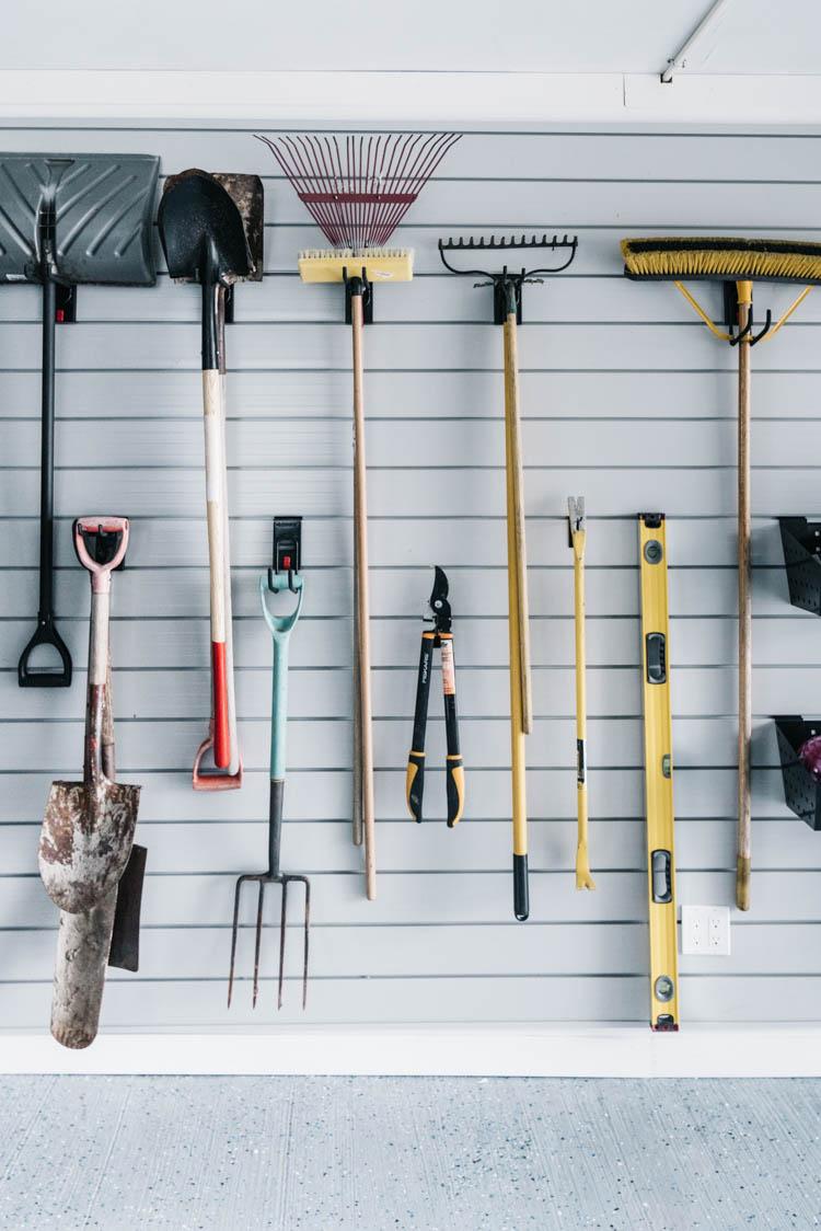 Yard tool storage in a garage
