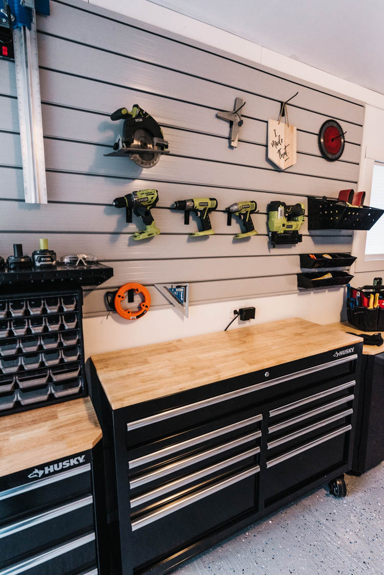 Garage track wall for tool storage
