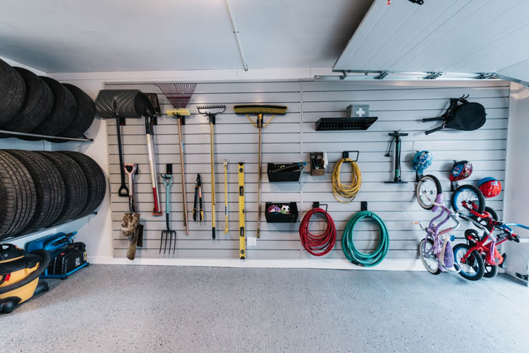 Massive slat wall storage for a small garage