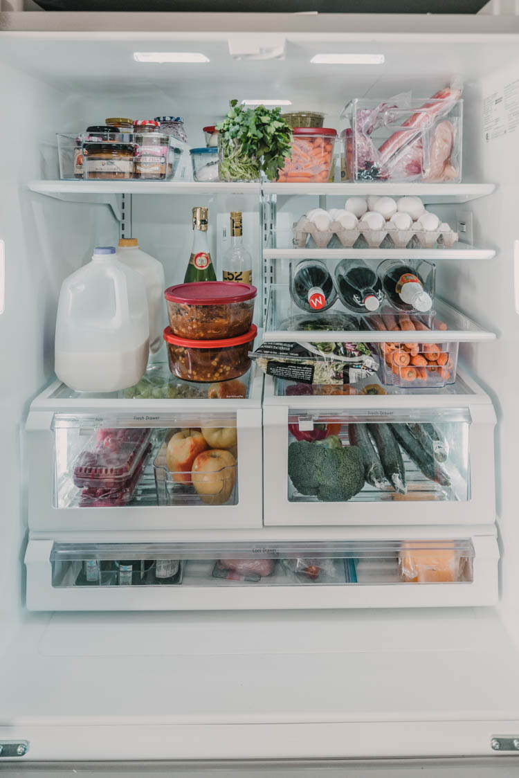 Fridge organization tips for families (love the use of the door storage)