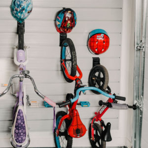 The best way to store kids bikes! Bike hooks with small hooks for helmet- slat wall storage