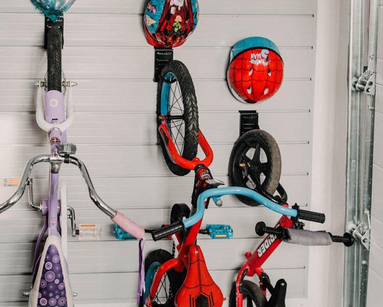 The best way to store kids bikes! Bike hooks with small hooks for helmet- slat wall storage