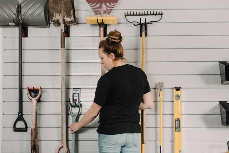 Yard tools on a slat wall
