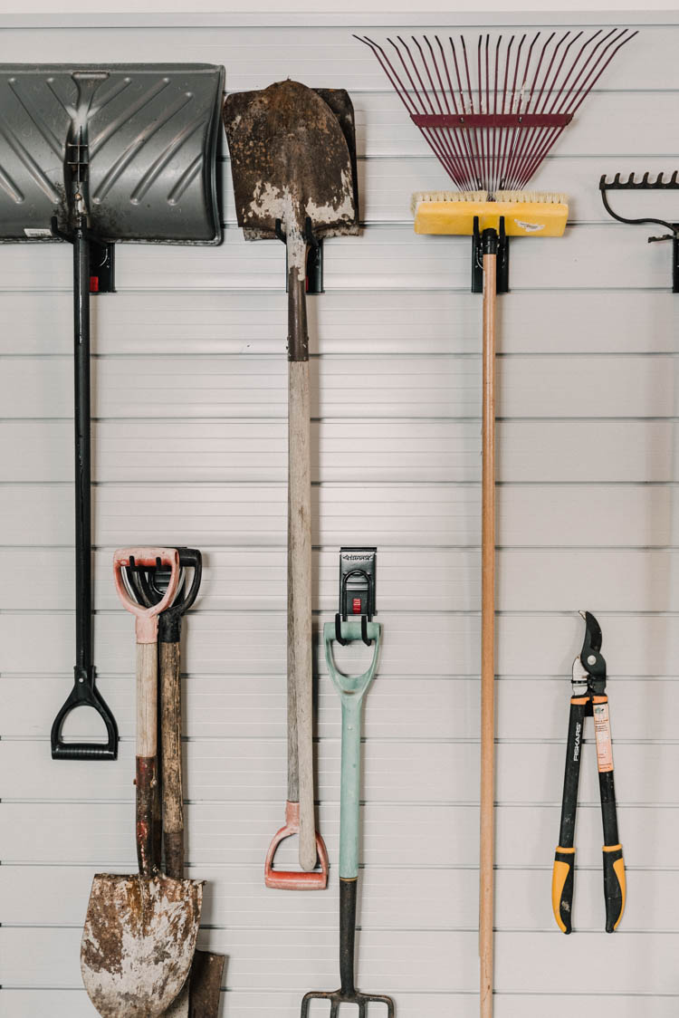 Yard tools on a slat wall... great tips to install it!
