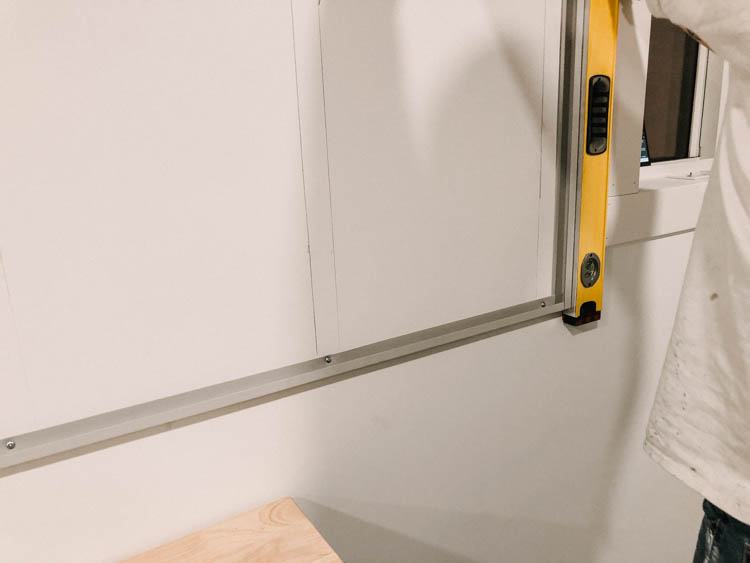 Install the bottom edge of slat wall first