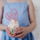 Girl holding cupcake with be mine cake topper