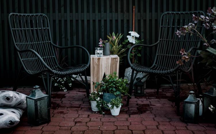 Modern brick patio- love the black wicker chairs!