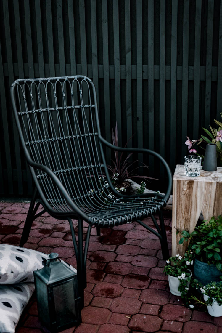 Choosing modern furniture for a traditional brick patio