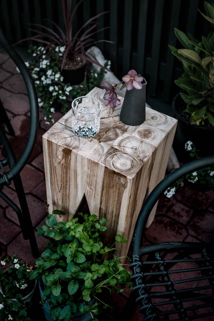 Modern brick patio- love this teak stool!