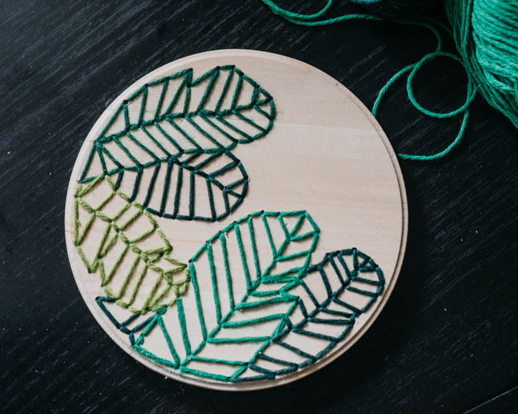 How to embroider on wood- love this modern take on a botanical embroidery hoop!