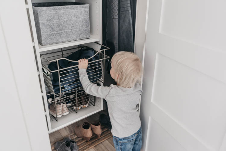 Tips to maximize storage in entry way closet organization for a family- these wire baskets are a great alternative to drawers for kids!