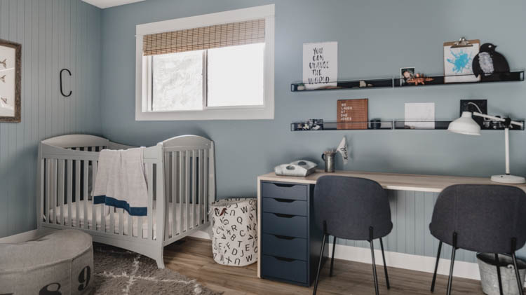 built in desk and crib in a shared boys room