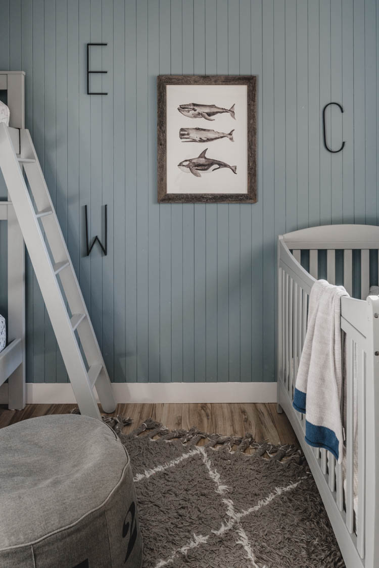 Skinny vertical shiplap wall for a boys shared bedroom
