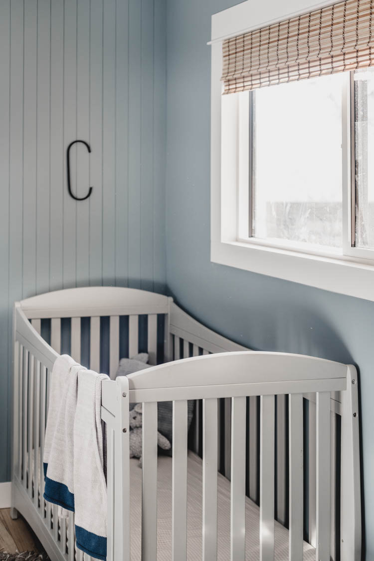 crib under window with skinny shiplap and wood shades (faux!)