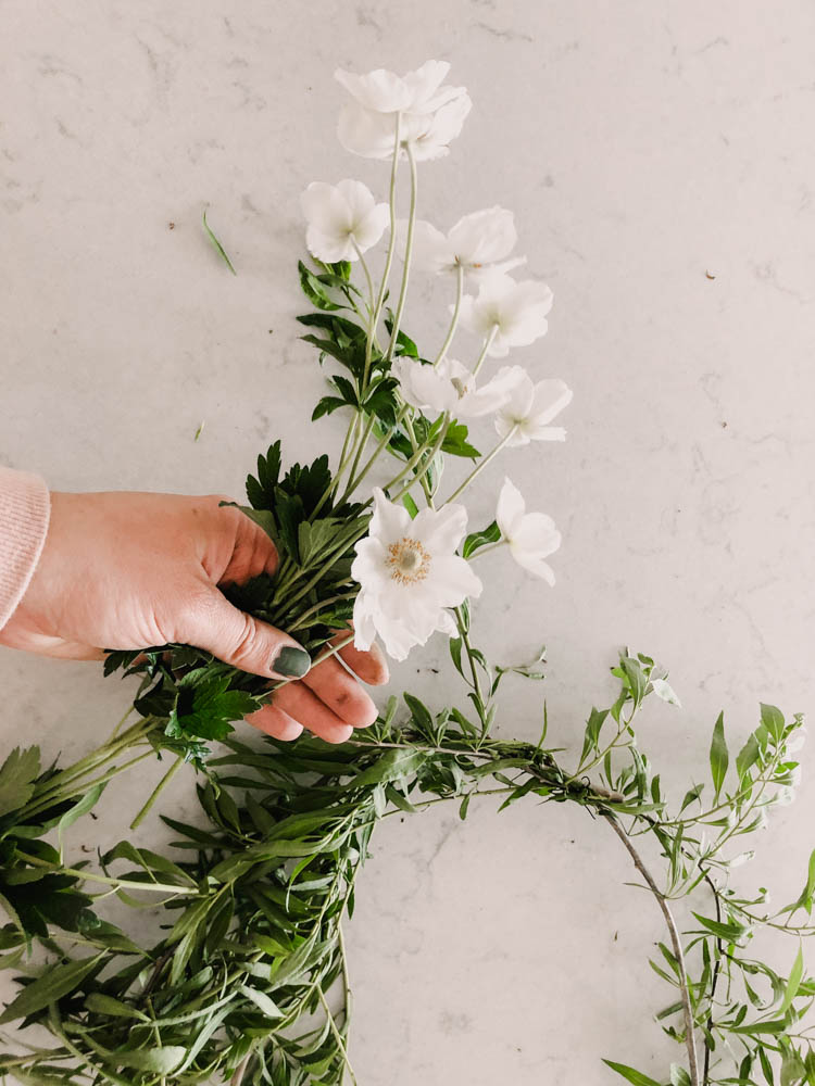 Arranging flowers for a fresh wreath
