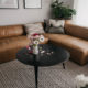 modern leather sectional with round coffee table for a family friendly home