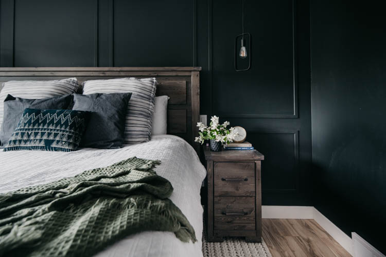 paneled moulding wall detail - black walls with hanging pendants in bedroom... love this moody room!