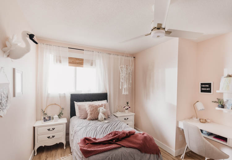 Sweet little girls bedroom with pink walls and neutral decor
