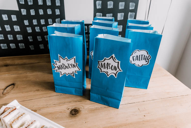 Simple party favor bags using dollar store paper bags, printer paper and a marker