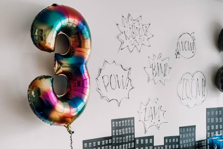 Cartoon word bubbles for a superhero birthday party- such a simple idea for a party backdrop!