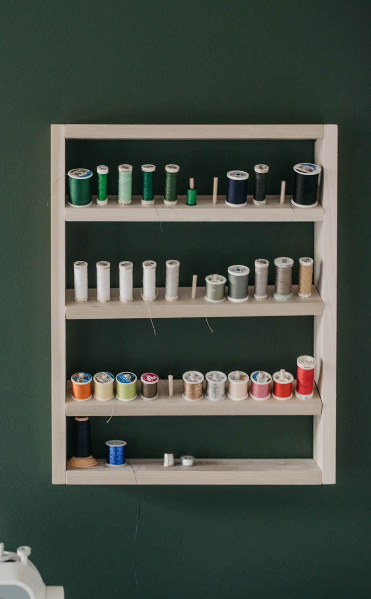 Free plans for a DIY thread shelf... such a great way to keep a sewing room organized!