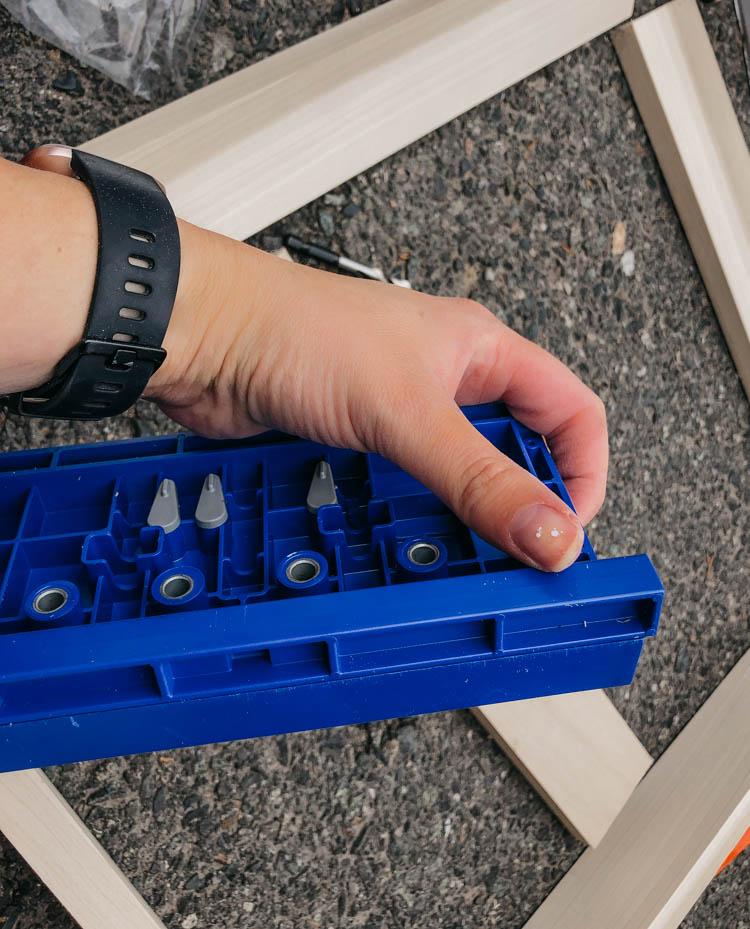 Adjusting the set back guard on the Shelf Pin Jig