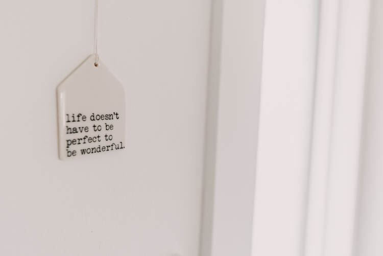 Little ceramic quote hung by the front door