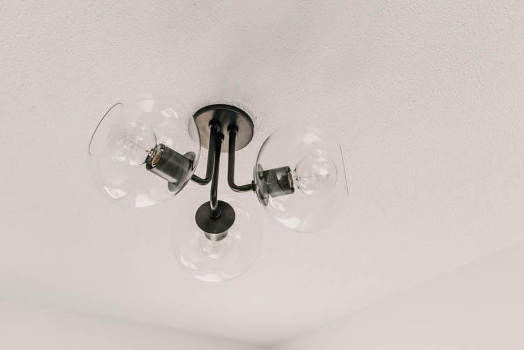 Modern semi flush mount light fixture- love the three glass globes on this one!
