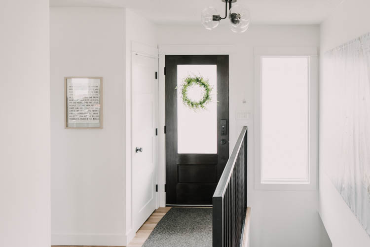Modern Entry Way Makeover with new door, railing, and flooring