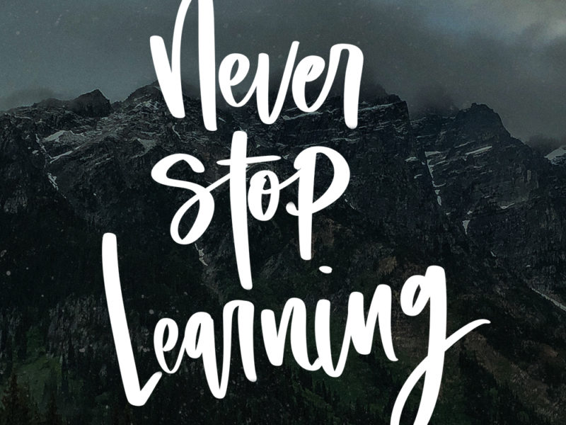 Never STop Learning hand lettered on mountains