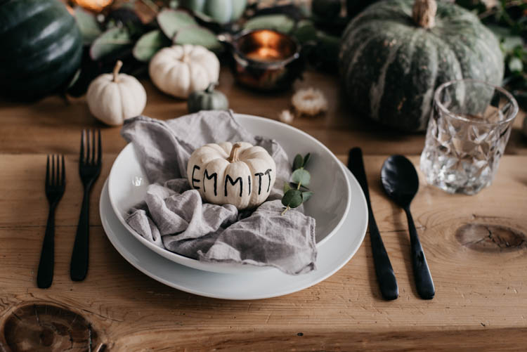 Hand Lettered mini pumpkins for place cards at a thanksgiving table